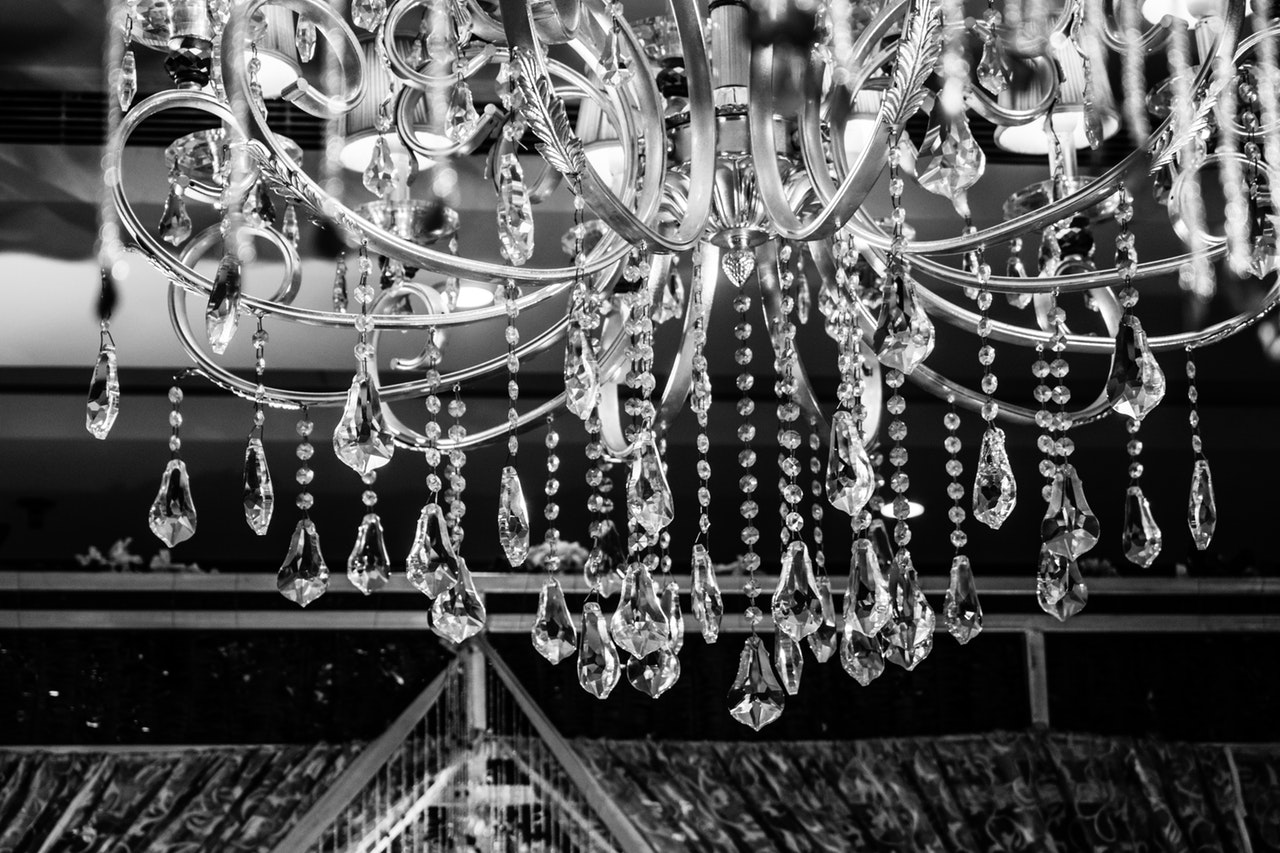 a black and white image of a chandelier/ how to decorate a chandelier for a party