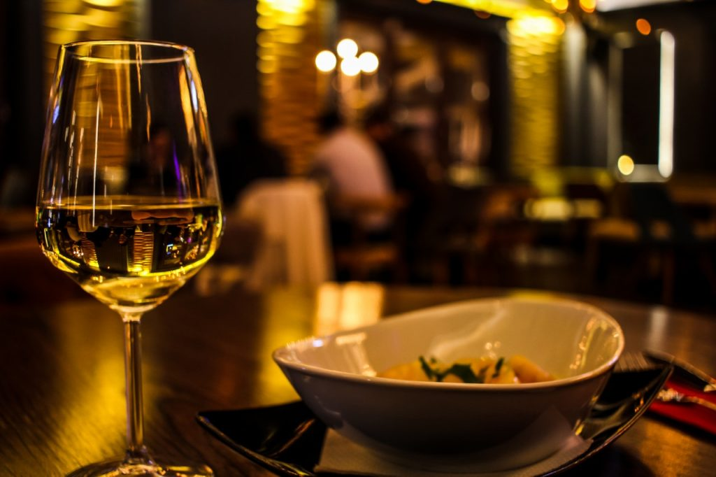 wine in a glass and plated food/Greek food wine pairings