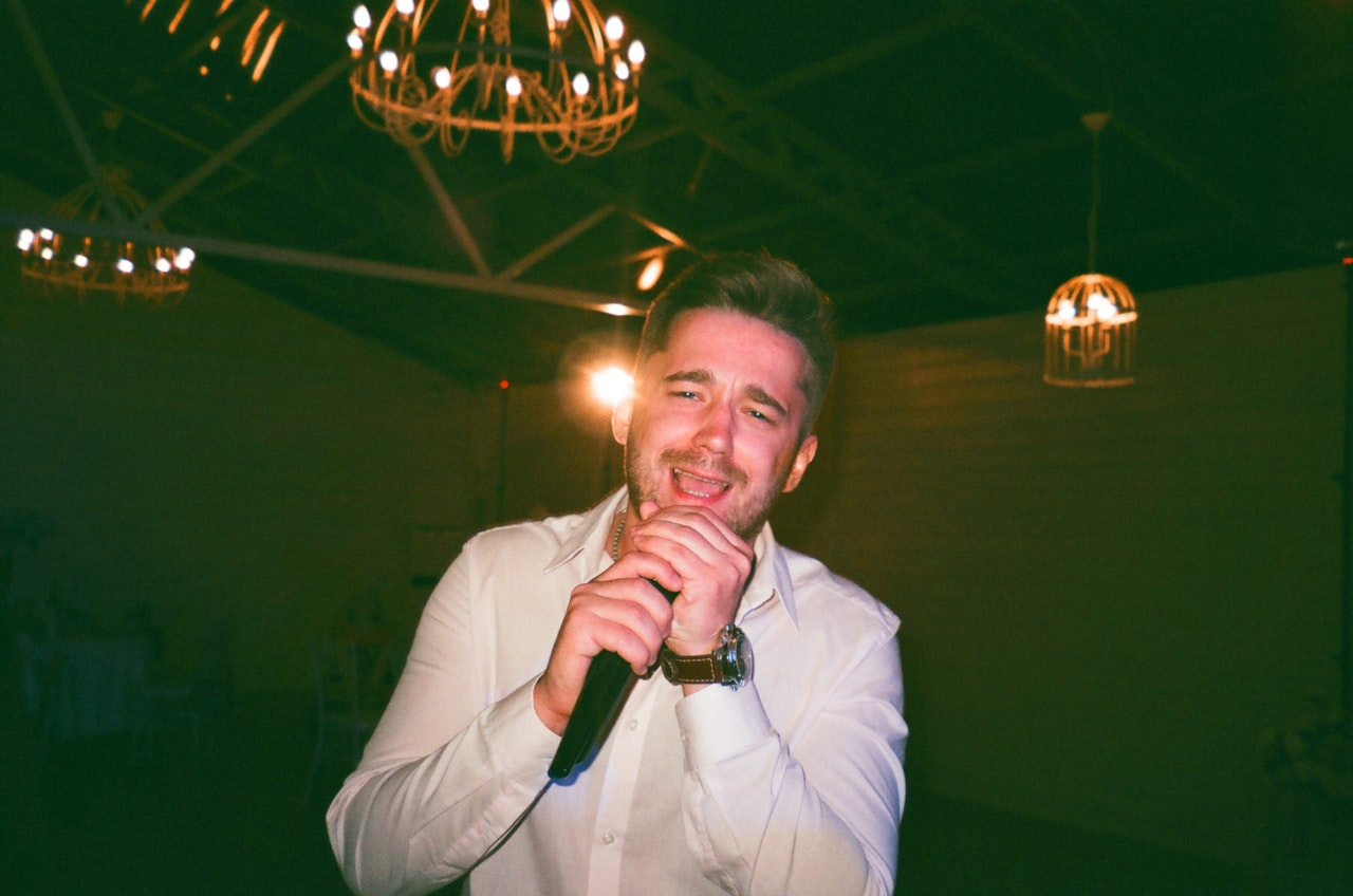 a man at the karaoke/karaoke party ideas for adults