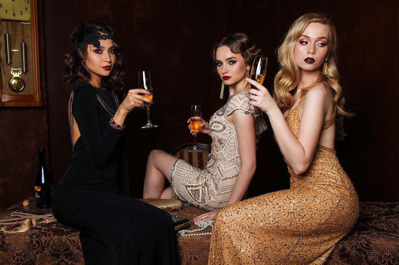 three woman holding drinks